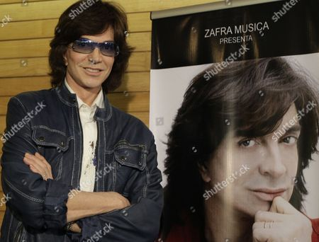 Camilo Sesto Spanish singer Camilo Sesto poses next to a poster depicting himself during a news conference in Mexico City. Sesto, accompanied by Angela Carrasco, will perform a series of farewell concerts during 2011 in U.S