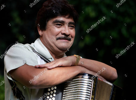 """Celso Pina Mexican accordionist Celso Pina poses for photographers during a news conference in Mexico City. Pina, who is known as the """"Rebelde del acordeón,"""" or rebel of the accordion, will return from a two year absence to his hometown of Monterrey on June 9 to present his album """"Zona Preferente - En Vivo desde el Auditorio Nacional,"""" or Preferred Zone; Live from the National Auditorium, spanning three decades of his music career"""