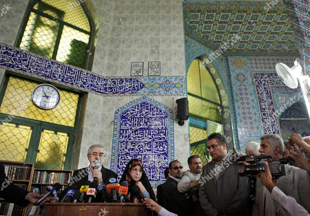 Stock Image of Mir Hossein Mousavi, Zahra Rahnavard Leading challenger and reformist candidate Mir Hossein Mousavi, left, speaks to the media after casting his vote with his wife Zahra Rahnavard, center-left, in the Iranian presidential elections at the Ershad mosque, on the outskirts of Tehran, Iran, . The election follows a hotly contested campaign pitting current president Mahmoud Ahmadinejad against leading challenger and reformist candidate Mir Hossein Mousavi, amongst others