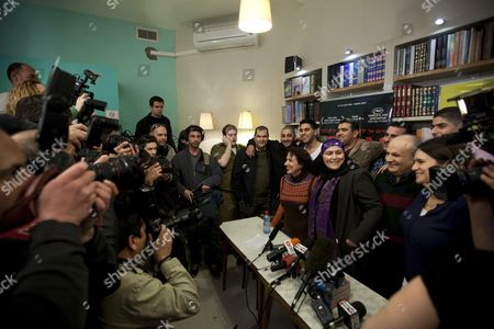 """Members of the Israeli film """"Ajami"""" pose for a group photo during a press conference at a cafe in Jaffa near Tel Aviv, Israel, . The movie """"Ajami"""", jointly directed by Palestinian Scandar Copti and Israeli Yaron Shani and set in a mixed Jewish-Arab district of Jaffa, was nominated on Tuesday for one of the top five foreign language films at the upcoming Academy Awards"""