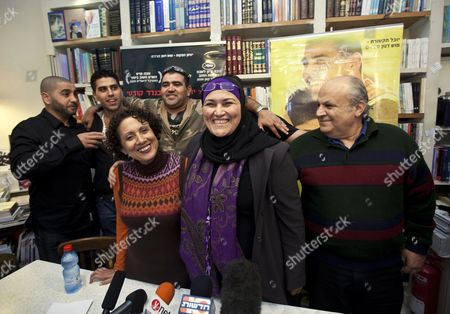 """Members of the Israeli film """"Ajami"""" pose for a group photo during a press conference at a cafe in Jaffa, near Tel Aviv, Israel, . The movie """"Ajami"""", jointly directed by Palestinian Scandar Copti and Israeli Yaron Shani and set in a mixed Jewish-Arab district of Jaffa, was nominated on Tuesday for one of the top five foreign language films at the upcoming Academy Awards"""