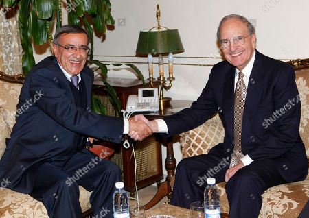 George Mitchell, Ali Shami U.S Middle East envoy George Mitchell, right, shakes hands with Lebanese Foreign Minister Ali Shami, left, at the Lebanese foreign ministry, in Beirut, Lebanon, . Mitchell arrived in Beirut for a two-day visit to meet with Lebanese officials and to talk about the Middle East peace process