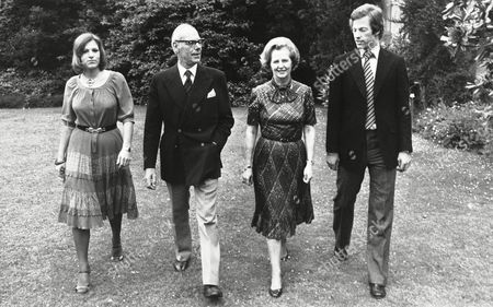 Margaret Thatcher, Denis Thatcher, Carol Thatcher, Mark Thatcher Britain's Conservative Party leader, Mrs. Margaret Thatcher, photographed during a stroll through the grounds of Scotney Castle in Kent, England, March 1979 where she is a tenant of a National Trust flat. With her in picture are her husband Denis, their twins Mark and Carol
