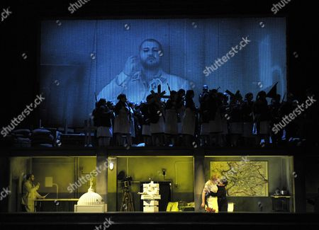 """Thiis file picture shows a szene of the fourth act of the opera 'Rienzi' by Richard Wagner photographed at the Deutsche Oper Berlin. The Berlin production turns Wagner's """"Rienzi"""" into a cautionary tale of 20th century fascism. Der Fuehrer would look kindly on the new production of """"Rienzi"""" that's playing at the Deutsche Oper of Berlin. Director Philipp Stoelzl has turned the title character from a 14th century Roman tribune into a 20th century fascist demagogue in an Alpine country that could easily be Germany. The chorus, directed by William Spaulding, got a huge and deserved ovation for its yeoman work all night. The splendid orchestra was conducted with vigor by Sebastian Lang-Lessing"""