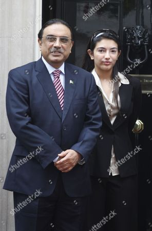 Asif Ali Zadari, Asifa Bhutto Zadari Pakistan's President Asif Ali Zadari, left, and his daughter Asifa Bhutto Zadari, right, pose for the photographers in London. Pakistan has sent a letter to Swiss authorities asking that they reopen a money-laundering case against President Asif Ali Zardari a government lawyer said Wednesday, March 31, 2010
