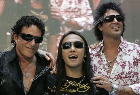 """Arnel Pineda Filipino singer-songwriter Arnel Pineda, center, the lead vocalist of American rock band """"Journey"""" smiles beside bandmates Neal Schon, left, and Deen Castronovo, right, during a press conference at a mall in suburban Quezon City, north of Manila, Philippines. American rock band Journey's lead vocalist Pineda said he's been putting together an album of his own compositions in his own voice which he plans to release in 2014. The singer spoke in an interview, during the launch of his version of the song """"Charity"""" in the animated children's music video Cha-Ching on Cartoon Network"""