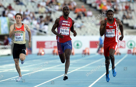 Germany's Christian Blum, left, Norway's Jaysuma Saidy Ndure, center, and Austria's Ryan Moseley compete in a Men's 100m heats during the European Athletics Championships, in Barcelona, Spain
