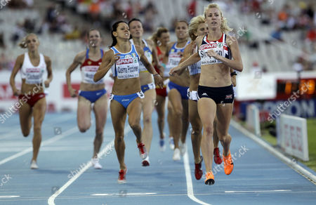 Britain's Jemma Simpson, right, competes in a Women's 800m heat during the European Athletics Championships, in Barcelona, Spain