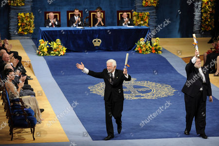 Martin Cooper, Raymond S. Tomlinson Martin Cooper, left and Raymond S. Tomlinson react after receiving the Technical and Scientific research award from Spain's crown Prince Felipe, unseen during the Prince of Asturias awards ceremony in Oviedo, Spain