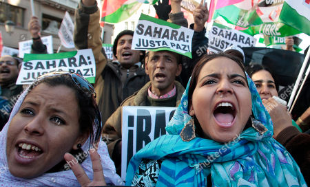 """People shout slogans against Morocco with banners that read, """"Sahara, Just Peace"""", during a march in support to Aminatou Haidar, a western Sahara independence activist who has been on a hunger strike for over a month in Madrid, . The activist from the disputed territory of Western Sahara reportedley has been flown back home"""