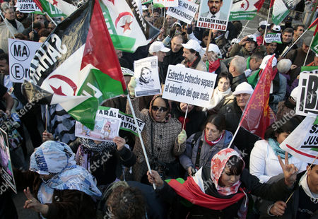 People take part in a march in support of Aminatou Haidar, a western Sahara independence activist who has been on a hunger strike for over a month in Madrid, . The activist from the disputed territory of Western Sahara has reportedly been flown back home