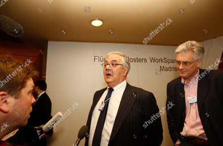 Barney Frank, Lord Adair Turner Congressman from Massachusetts and Chairman of the Financial Services Committee, USA, Barney Frank, left, and Chairman of the Financial Services Authority, UK, Lord Adair Turner, right, speak with the media after a meeting of bankers at the World Economic Forum in Davos, Switzerland on