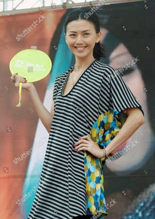 """Stefanie Sun Famed Singapore singer Stefanie Sun poses for photographers during a media event announcing her concert """"The Answer is !K!K,"""", in Taipei, Taiwan. Stefanie will perform on May 15-16 at Taipei Arena"""