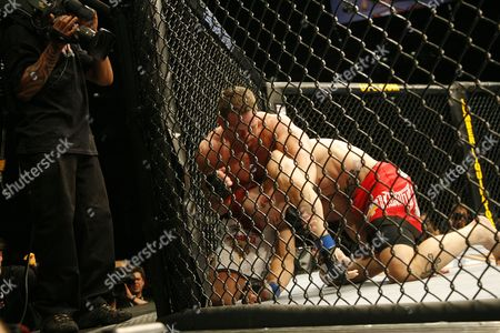 Dan Hardy, Marcus Davis Dan Hardy, right, of England, is put in a headlock by U.S. Marcus Davis, of Bangor, Maine, during their Ultimate Fighting Championship bout in Cologne, Germany, on . The Ultimate Fighting Championship UFC is the world leading professional mixed martial arts MMA organization. **Eds Note: German spelling of Cologne is Koeln