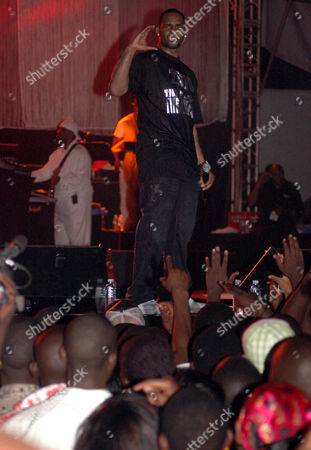 Stock Picture of American R&B superstar R Kelly best known by the stage name R. Kelly performs in Uganda's capital city Kampala organized by Zain Uganda,. The American R&B and soul singer song writer, occasional rapper, and record producer performed before a crowd of about 30,000 fans