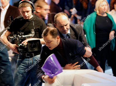 Oleg Lyashko A Presidential bodyguard stops Oleg Lyashko, foreground, a flamboyant lawmaker from Yulia Tymoshenko's election block from entering the television studio during a live talk show with president Viktor Yushchenko, unseen, in Kiev, Ukraine, . The lamwker, Oleg Lyashko wanted to complain about Yushchenko's policies and present him with some documents during the live show. He was ignored by the talk show host, Savik Shuster, and left the studio in the middle of the show