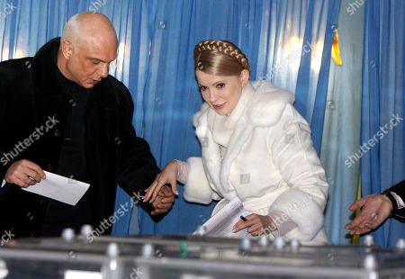 Stock Image of Yulia Tymoshenko, Oleksandr Tymoshenko Ukraine's Prime Minister and presidential candidate Yulia Tymoshenko leaves a booth as her husband Oleksandr, left, assists to her at a polling station during presidential election in Dnipropetrovsk, Ukraine