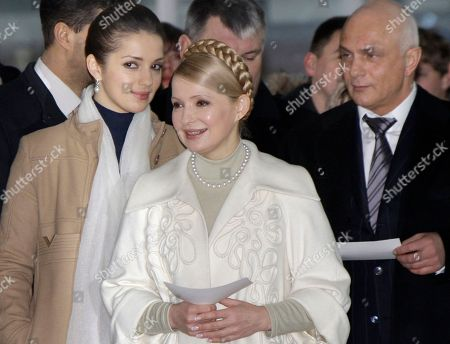 Stock Picture of YuliaTymoshenko, Yevgenia Tymoshenko, Oleksandr Tymoshenko Ukraine's Prime Minister and presidential candidate Yulia Tymoshenko, center, flanked by her daughter Yevgenia, left, and husband Oleksandr walks to vote during the presidential election at a polling station in Dnipropetrovsk, Ukraine, . Ukraine's 37 million registered voters will choose between Russian-leaning opposition leader Viktor Yanukovych and Tymoshenko, who came to international prominence in the 2004 pro-Western Orange protests