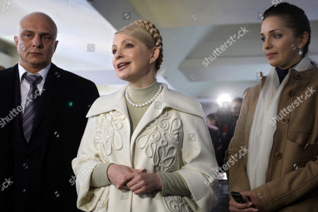 YuliaTymoshenko, Yevgenia Tymoshenko, Oleksandr Tymoshenko Ukraine's Prime Minister and presidential candidate Yulia Tymoshenko, center, flanked by her daughter Yevgenia, right, and husband Oleksandr, left, speaks to the media during the presidential election at a polling station in Dnipropetrovsk, Ukraine, . Ukraine's 37 million registered voters will choose between Russian-leaning opposition leader Viktor Yanukovych and Tymoshenko, who came to international prominence in the 2004 pro-Western Orange protests