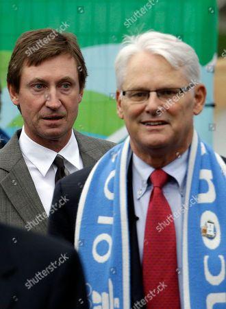 Wayne Gretzky, Gordon Campbell Former hockey star and 1988 Winter Games Olympian Wayne Gretzky, left, follows Premier Gordon Campbell at an event at David Lam Park in Vancouver, British Columbia