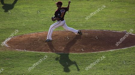 Andrew Baldwin Puerto Rico's pitcher Andrew Baldwin throws to the Dominican Republic in the first inning of a Caribbean Series baseball game in Porlamar on Margarita Island, Venezuela