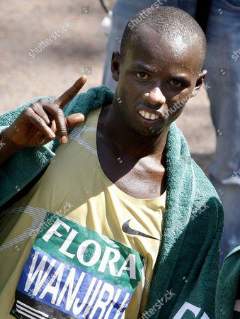 Sammy Wanjiru Kenya's Sammy Wanjiru celebrates after winning the men's London Marathon in London. Wanjiru died in Kenya early, after jumping from a balcony, police said