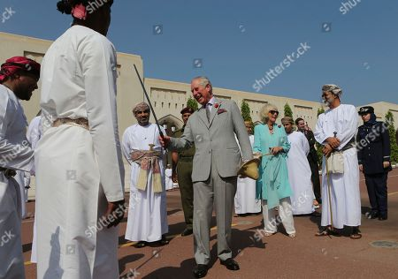 Britain's Prince Charles dances with a sword with a group of Omani traditional dancers in Muscat, Oman, . Prince Charles and his wife Camilla have started a three-nation royal tour of the Gulf in Oman. Prince Charles landed in Muscat on Friday night, greeted at the airport by Omani Heritage and Culture Minister Sayyid Haitham Bin Tariq Al Said