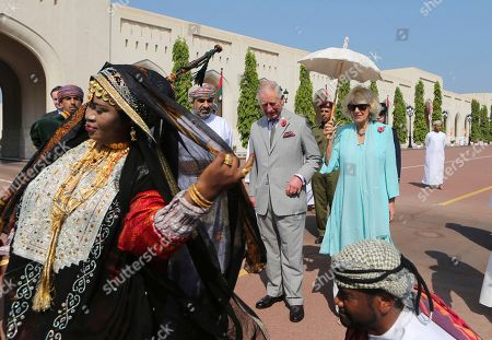 Britain's Prince Charles, center, and his wife Camilla, right, watch a group of traditional dancers in Muscat, Oman, . Britain's Prince Charles and his wife Camilla have started a three-nation royal tour of the Gulf in Oman. Prince Charles landed in Muscat on Friday night, greeted at the airport by Omani Heritage and Culture Minister Sayyid Haitham Bin Tariq Al Said. Camilla landed earlier Friday