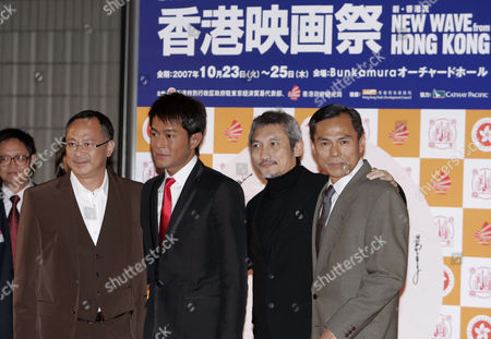 Stock Photo of Johnnie To, Tsui Hark, Louis Koo, Ringo Lam From left: Hong Kong actor Johnnie To, director Tsui Hark, actors Louis Koo and Ringo Lam, pose for photographers at the opening ceremony of the Hong Kong Film Festival in Tokyo