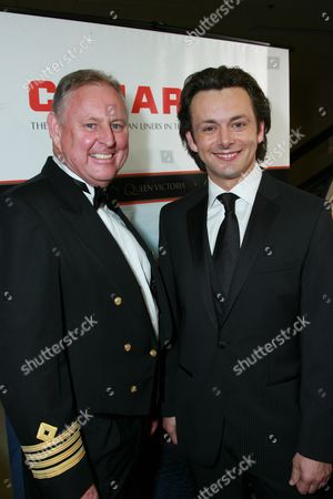 Stock Picture of Cunard Captain David Christie and Michael Sheen