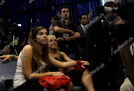 Dalma Maradona, Claudia Villafane Diego Maradona's daughter Dalma Maradona, left, and his former wife Claudia Villafane, second from left, looks on during press conference of new Argentina's soccer head coach Diego Maradona, not in picture, at the Argentine Football Association in Buenos Aires, . Maradona replaces Alfio Basile, who stepped down Oct. 16, one day after a historic 1-0 loss against neighboring Chile in World Cup qualifiers. Maradona's coaching team has still not been officially announced