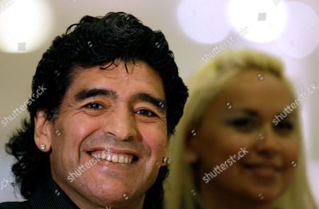 Diego Maradona, Veronica Ojeda Argentina's national soccer team coach Diego Maradona, left, and his girlfriend Veronica Ojeda attend the opening ceremony of a shopping center in Buenos Aires