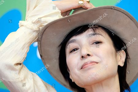 """Japanese actress Kaori Momoi poses during the photo call for the movie """"Sukiyaki Western Django"""" at the 64th Venice Film Festival, in Venice, Italy. The film world of Asia is too busy making movies of its own to fret much about the debate slamming Hollywood - the casting of white people in roles written for Asians. Momoi, who appeared in """"Memoirs of a Geisha,"""" as well as Russian filmmaker Aleksandr Sokurov's """"The Sun,"""" suggested acting was ultimately about individual talent, not skin color or nationality"""