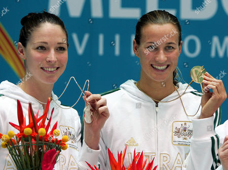 Australia's Giaan Rooney, silver, left, and Australia's Sophie Edington, gold, smile during the medal ceremony for the Women's 100m backstroke at the Commomwealth Games at the Sports and Aquatic Center in Melbourne, Australia