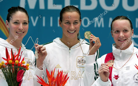 From left, Australia's Giaan Rooney, silver, Australia's Sophie Edington, gold, and England's Melanie Marshall, bronze, during the medal ceremony for the Women's 100m backstroke at the Commomwealth Games at the Sports and Aquatic Center in Melbourne, Australia
