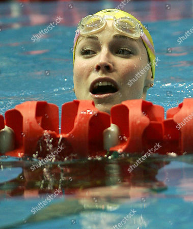 Australia's Giaan Rooney leaves the pool after winning her Women's 50m backstroke heat at the Commomwealth Games at the Sports and Aquatic Center in Melbourne, Australia