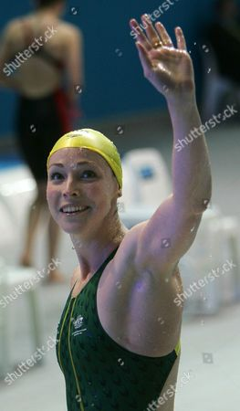Stock Photo of Australia's Giaan Rooney celebrates after winning her Women's 50m backstroke heat at the Commomwealth Games at the Sports and Aquatic Center in Melbourne, Australia