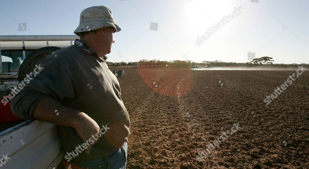 Glen Phillips Glen Phillips watches as his son Darcy sprays herbicide on his farm near Poochera, on South Australia's Eyre Peninsula, 640 km (400 miles) west of Adelaide, Australia, . This season's lack of rain would mean a third year of drought in South Australia's Eyre Peninsula, where Phillips has farmed for 34 years