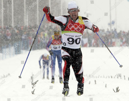 """Martin Tauber Austria's Martin Tauber crosses the finish line to take the 8th place during the Men's 15k Classical Cross Country race at the Turin 2006 Winter Olympic Games in Pragelato Plan, Italy, . The head of the Austrian Ski Federation vowed April 25, 2007 that his organization would """"get to the bottom"""" of a doping scandal at the 2006 Winter Games in Turin that has led to the banning for life of six Austrian athletes from the Olympics. The IOC identified the banned Austrians as retired biathletes Wolfgang Perner and Wolfgang Rottmann, and cross-country skiers Martin Tauber, Juergen Pinter, Johannes Eder and Roland Diethart"""