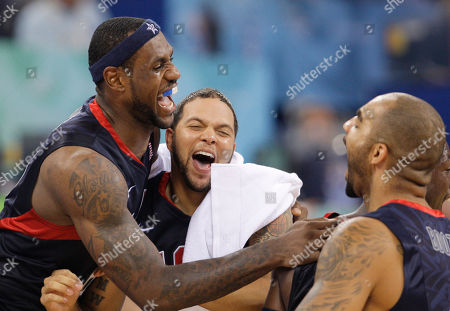 USA players Lebron James, left, Deron Williams, center, and Carlos Boozer, right, celebrate following their win over Spain in their men's gold medal basketball game at the Beijing 2008 Olympics in Beijing