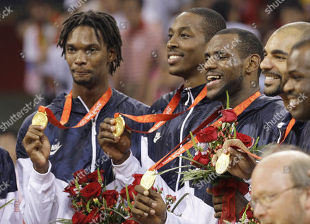 USA player receive their gold medal following their win over Spain in the gold medal basketball game at the Beijing 2008 Olympics in Beijing, . From left are Chris Bosh, Dwight Howard, Lebron James and Carlos Boozer