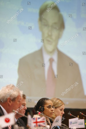 Stock Picture of Elliot Morley, Renato Casa Grande, Marina Silva, Pamela Cox World Bank President Robert B. Zoellick is seen on a large Tv screen as his pre-recorded message is shown during the Brasilia G8+5 Legislator Forum at Itamaraty palace in Brasilia, . From left to right are President of Globe International Elliot Morley,Brazil's Senator Renato Casa Grande, Brazil's Environment Minister Marina Silva, and Vice President of the World Bank for Latin America & the Caribbean Pamela Cox