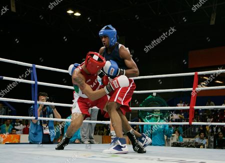 Pedro Lima, Demetrius Andrade Brazil's Pedro Lima, left, fights against U.S. Demtrius Andrade during a Panamerican Games men's boxing welter 69 kg final competition, in Rio de Janeiro, . Lima won the gold medal and Andrade the silver