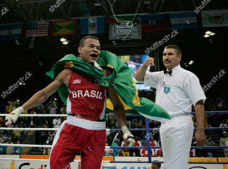Stock Picture of Pedro Lima Brazil's Pedro Lima, right, celebrates after a fight against US' Demtrius Andrade during a Pan American Games men's boxing welterweight 69 kg final competition, in Rio de Janeiro, . Lima won the gold medal