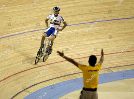 Absalon Martinez; Diana Garcia The coach for Colombia's cycling team, Absalon Martinez, right, extends his arms to embrace Diana Garcia after she won the gold medal for the women's sprint cycling at the Pan American Games in Rio de Janeiro