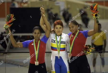 Lizandra Guerra; Diana Maria Garcia Orrego; Arianna Herrera Winners of the women's sprint cycling competition show their medals during the award ceremony at the Pan American Games in Rio, . From left are Cuba's Lizandra Guerra, who won the silver, Columbia's Diana Garcia, who won the gold and Cuba's Arianna Herrera, who won the bronze