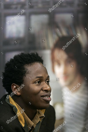 Ishmael Beah Ishmael Beah from Sierra Leone, author of the book 'A Long Way Gone: Memoirs of a boy soldier' chats to his fan during a book signing at Brunel University in west London