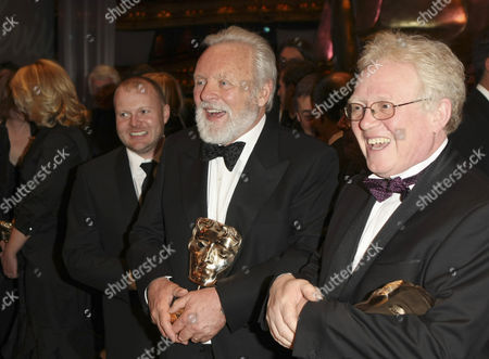 Sir Anthony Hopkins, Mark Herbert, Christopher Gunning, BAFTA Actor Sir Anthony Hopkins, centre, who won the Academy Fellowship award shares a joke with British producer Mark Herbert, left, who won the Best British Film award for 'This is England' and British composer Christopher Gunning, who won the award for Best Music in 'La Vie en Rose' at the British Academy Film Awards 2008 at the Royal Opera House in London
