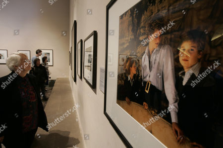 A 1992 picture of late Princess Diana, accompanied by her two sons Prince William and Prince Harry, by photographer Derry Moore can be seen among others during the exhibition 'Diana, Princess of Wales' at central London's National Portrait Gallery, . The mounds of flowers are long gone from the gates of Kensington Palace, but the presence of Diana lingers. It has been 10 years since her death in a Paris car crash, when many Britons were poleaxed by grief for a vivacious and troubled woman who was at once princess, style icon, charity worker and tabloid celebrity. The Aug. 31 anniversary will be marked with a nationally televised memorial service and specially commissioned prayers