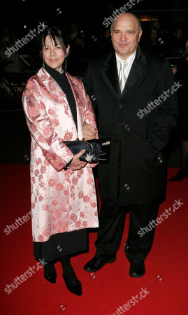 Anthony Minghella, Carolyn Choa British director Anthony Minghella, right, with his wife choreographer Carolyn Choa, attend the screening of Eastern promises, which is the opening night gala of The 51st London Film Festival, in central London